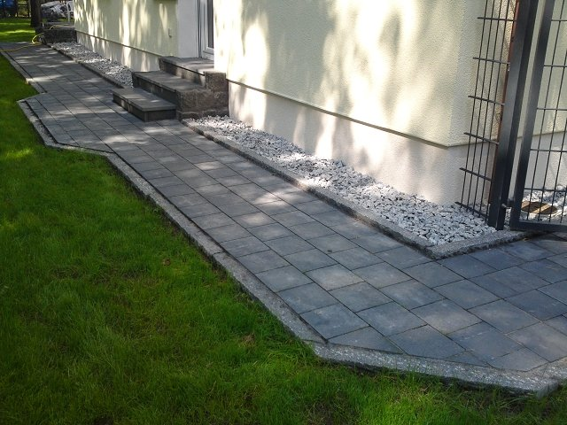 Granit Natursteinplatten und Granit Grosssteinmauer